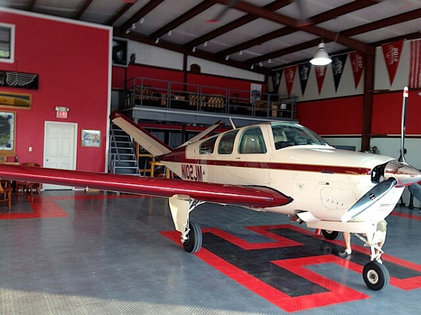 "Airplane hangar with RaceDeck Diamond and custom ""H"" Design."
