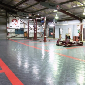 Commercial garage with RaceDeck Diamond flooring and Free-Flow over the drain.