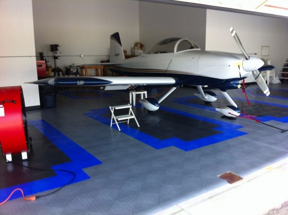 Airplane hangar with RaceDeck Diamond alloy, royal blue, and black