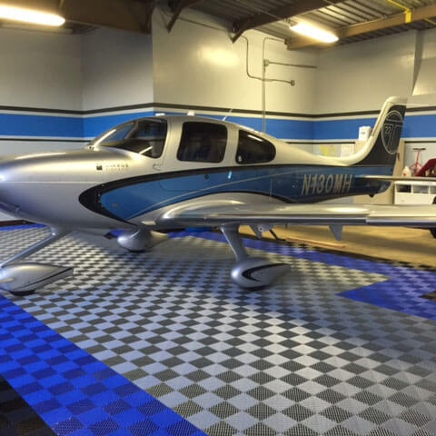 RaceDeck Free-Flow self-draining flooring is a great choice for hangars and garages alike.
