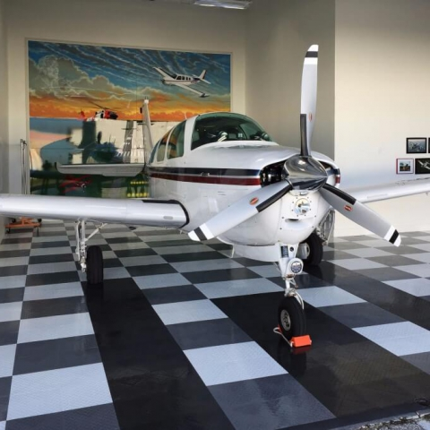 Airplane in a hangar with RaceDeck Diamond flooring.