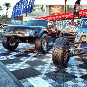 Ultra Motorsports display with Free-Flow flooring, custom logos and edging