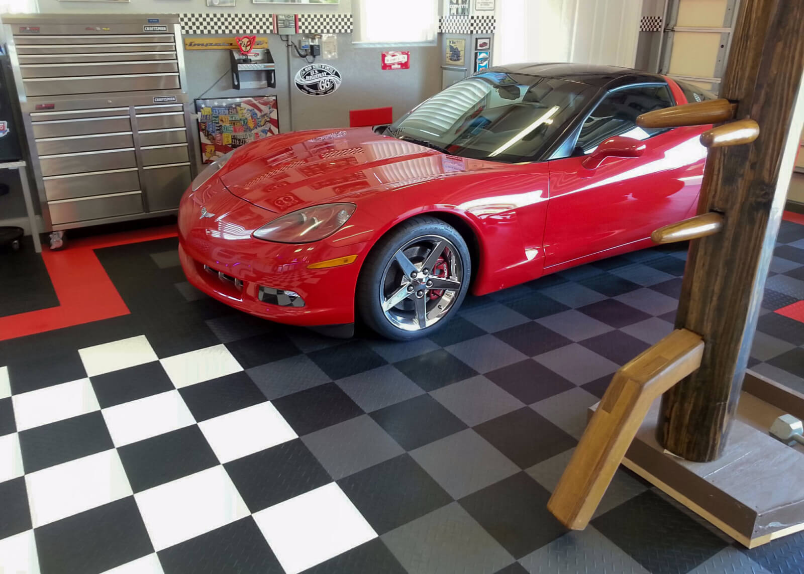 Little Red Corvette on custom garage floor