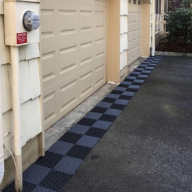 Free-Flow tiles used to provide drainage outside this garage.