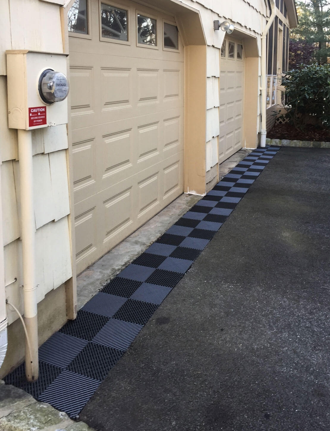 Free-Flow being used for drainage outside a garage.