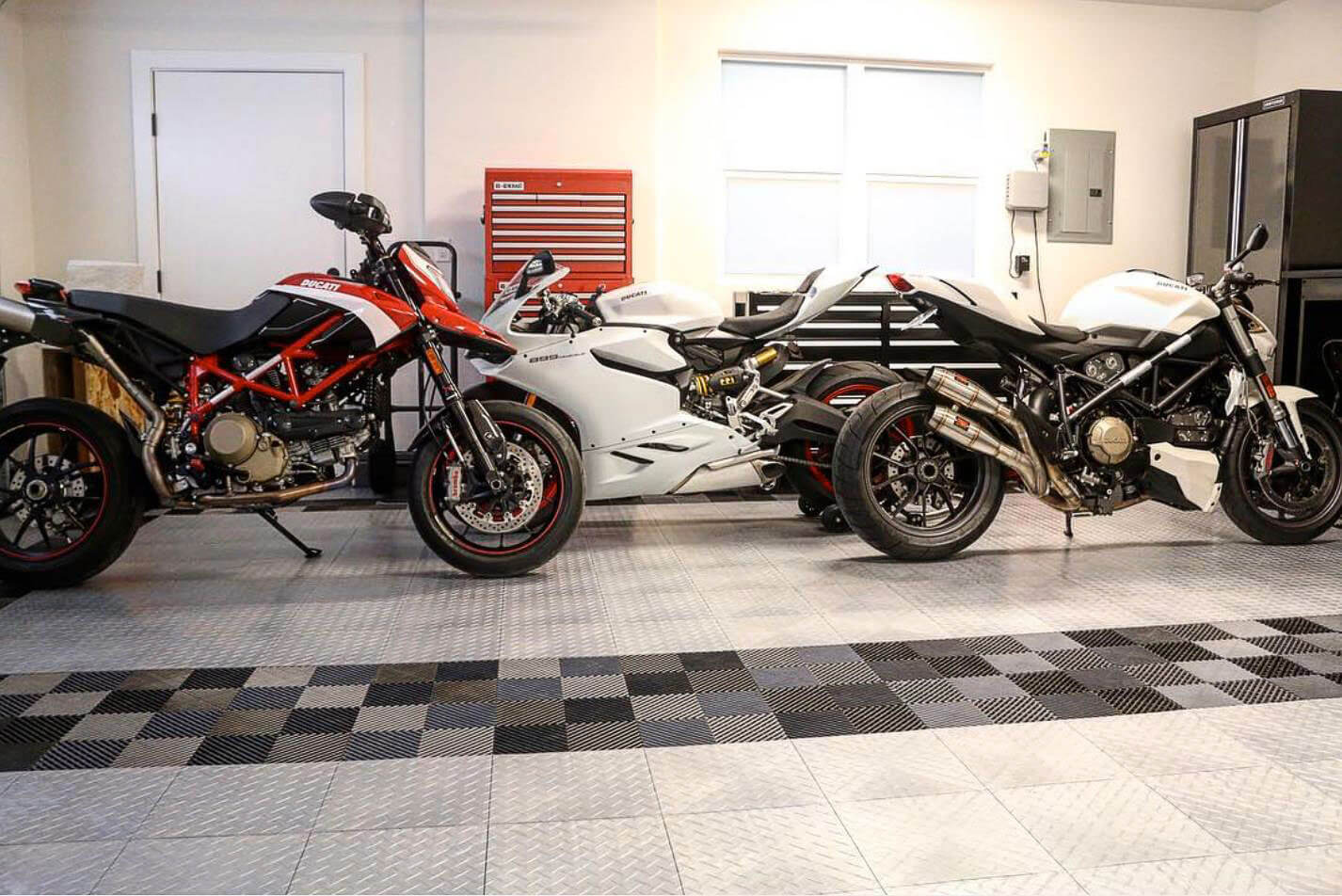 Ducati home garage with RaceDeck Diamond and Free-Flow flooring.