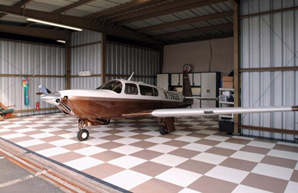 Brown and white airplane hangar
