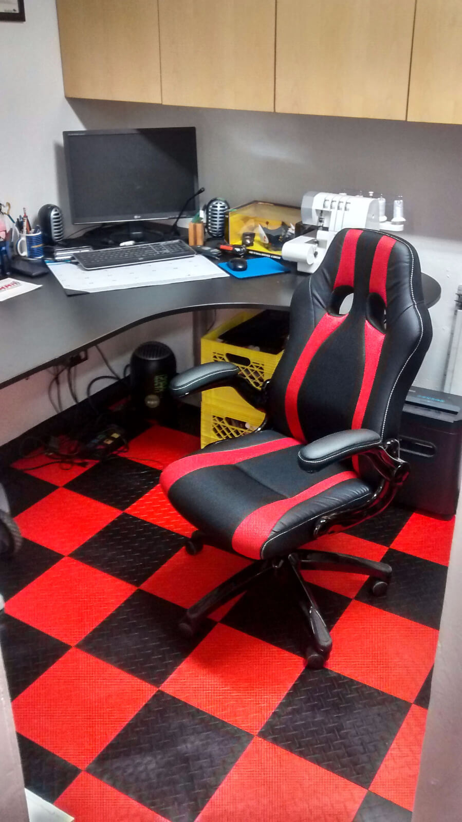 The black and red flooring extends to this office area.