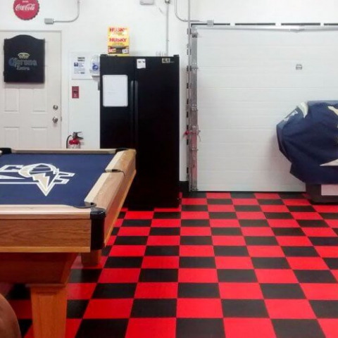 Home garage and lounge space wtih checkered black and white RaceDeck flooring.