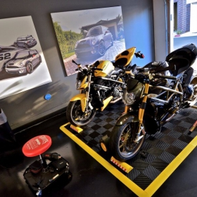 A black Free-Flow motorcycle pad with yellow edging creates a striking and clean display.
