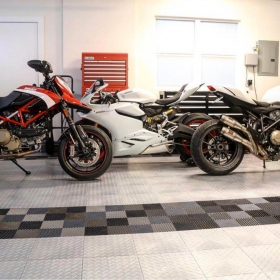 Motorcycle garage with Racedeck Diamond and Free-Flow flooring.