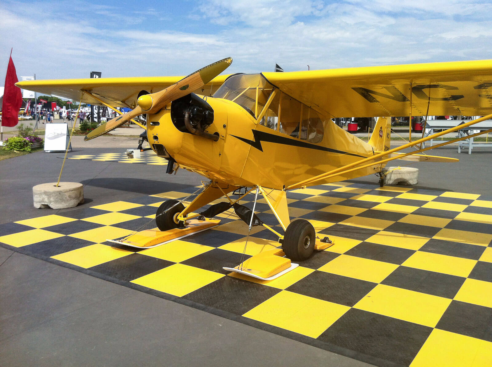Portable airplane display with RaceDeck Diamond black and yellow, with edging