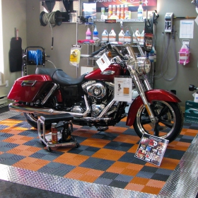 Pop display with a motorcycle, Free-Flow flooring and RaceDeck Pro.