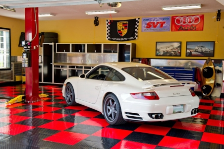 Porsche in a home shop with TuffShield red and black