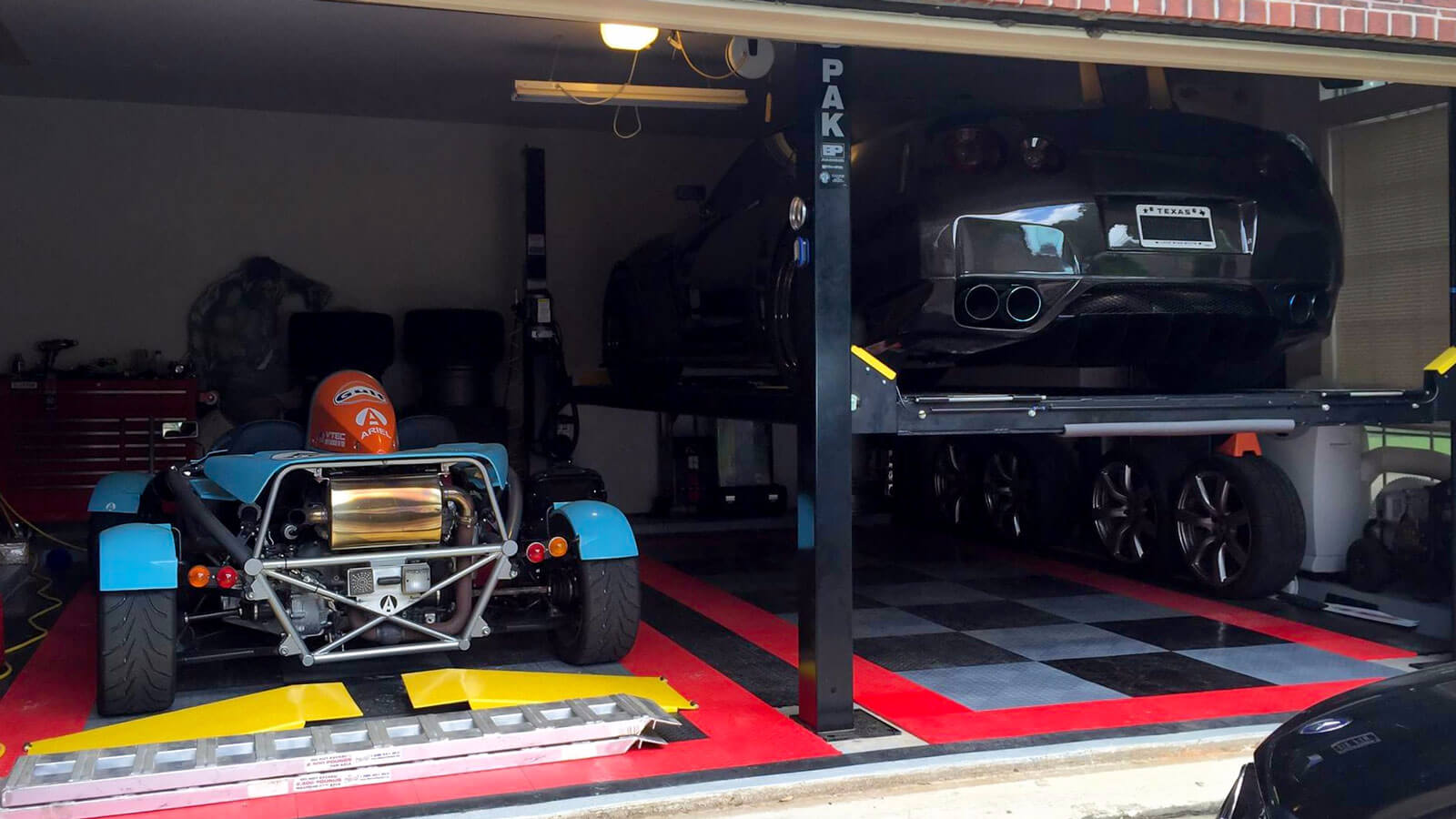 Garage with RaceDeck black, alloy, and red