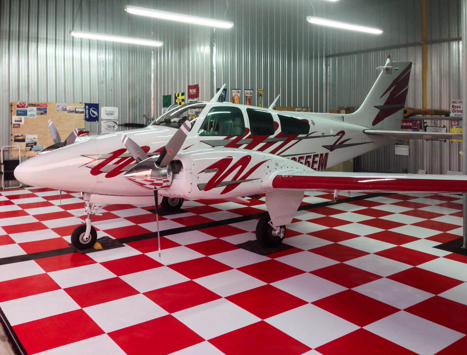 Red and white checkered RaceDeck Diamond flooring for a red and white plane.