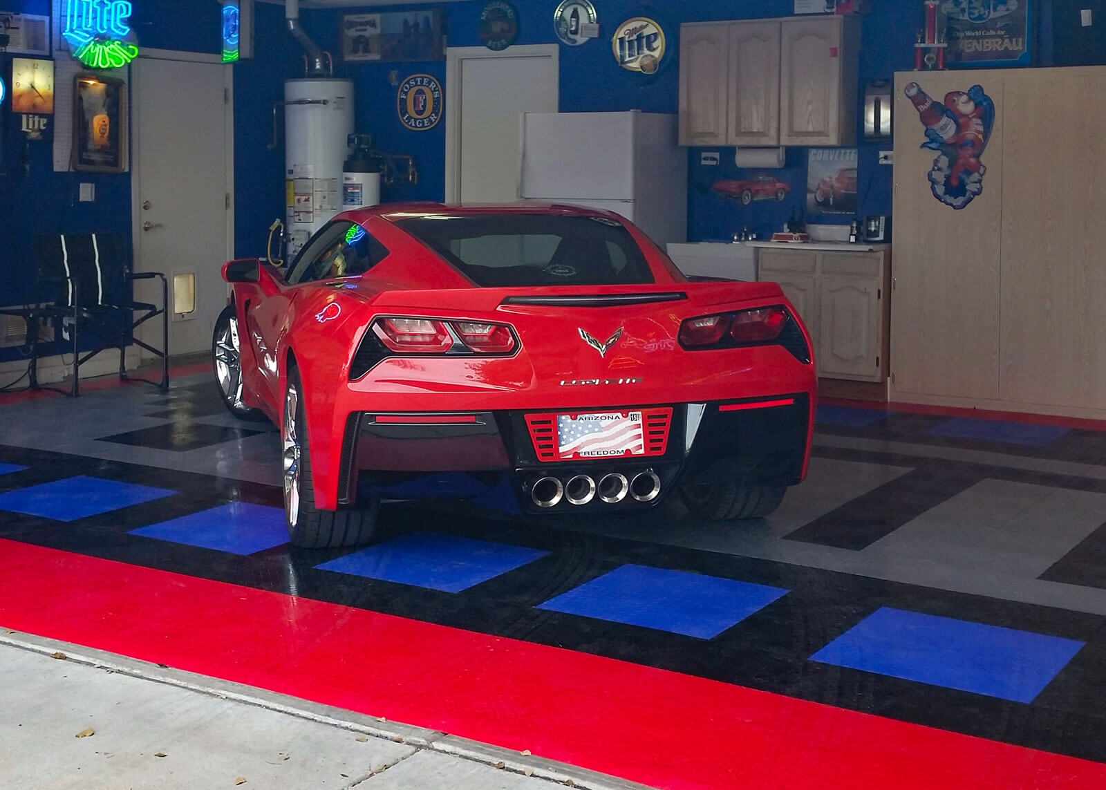 Corvette in a garage with RaceDeck flooring