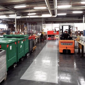 Manufacturing area with RaceDdeck Diamond flooring in alloy and graphite.