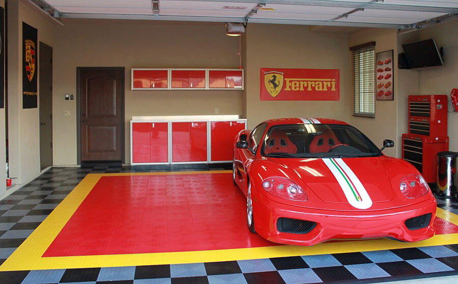 Ferrari garage with RaceDeck Diamond in black, alloy, yellow and red.