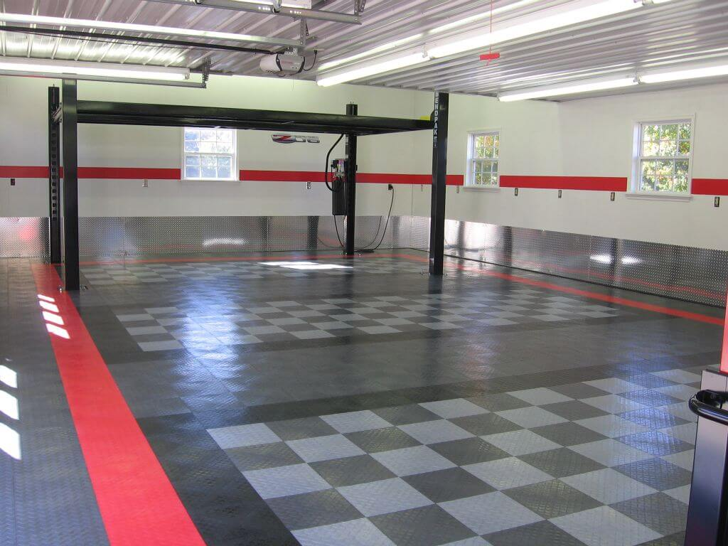 RaceDeck Diamond in black, graphite, alloy and red set the layout of this garage.