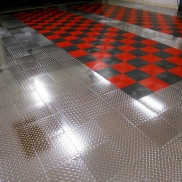 Polished aluminum RaceDeck Pro and checkered RaceDeck Diamond organize this garage space.