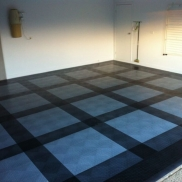 Black, graphite, and alloy RaceDeck Diamond create a clean plaid pattern in this home garage.