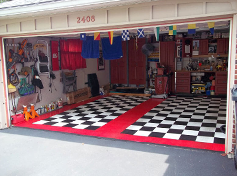 Two-car home garage with RaceDeck Diamond black, white, and red flooring.