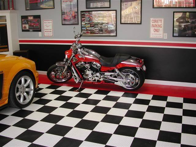 Checkered black and white RaceDeck Diamond with a red border show off this motorcycle and car.