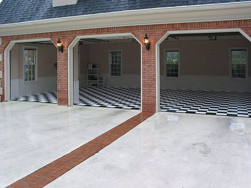 3-car garage with black and white RaceDeck Diamond flooring.