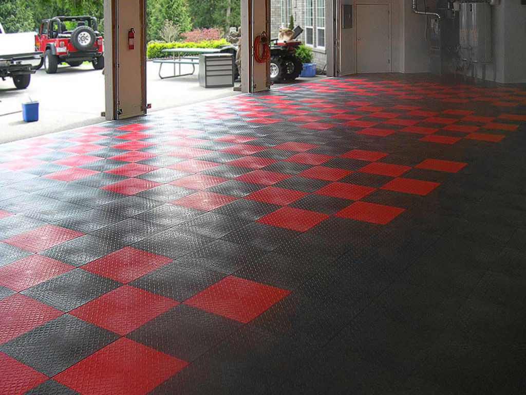 Custom car-width checkered designs made with RaceDeck Diamond in red and graphite.