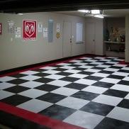 Dodge garage with black, white and red RaceDeck Diamond flooring.