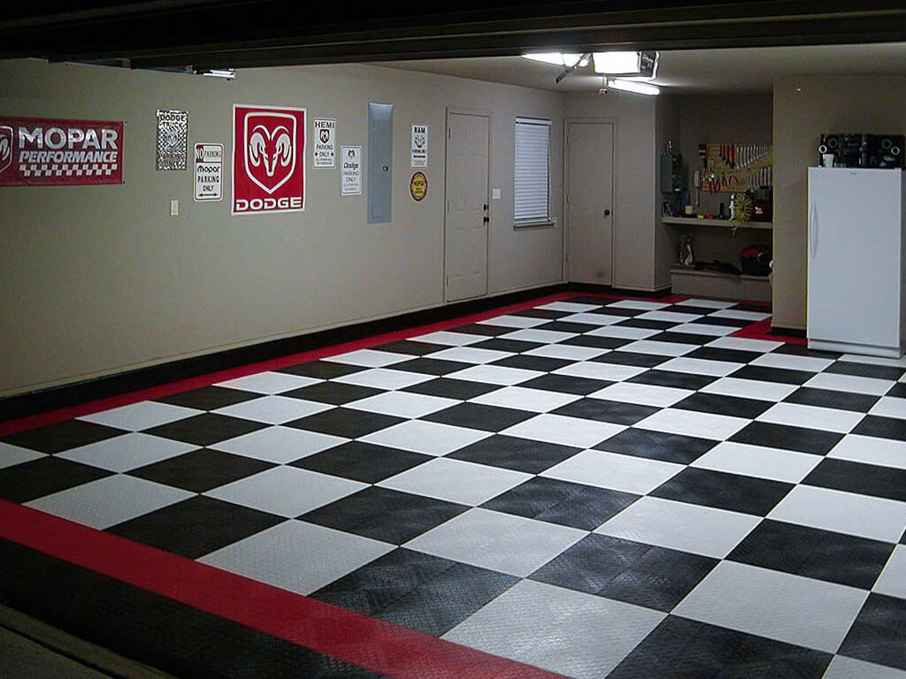 Dodge garage with black, white and red RaceDeck Diamond flooring.