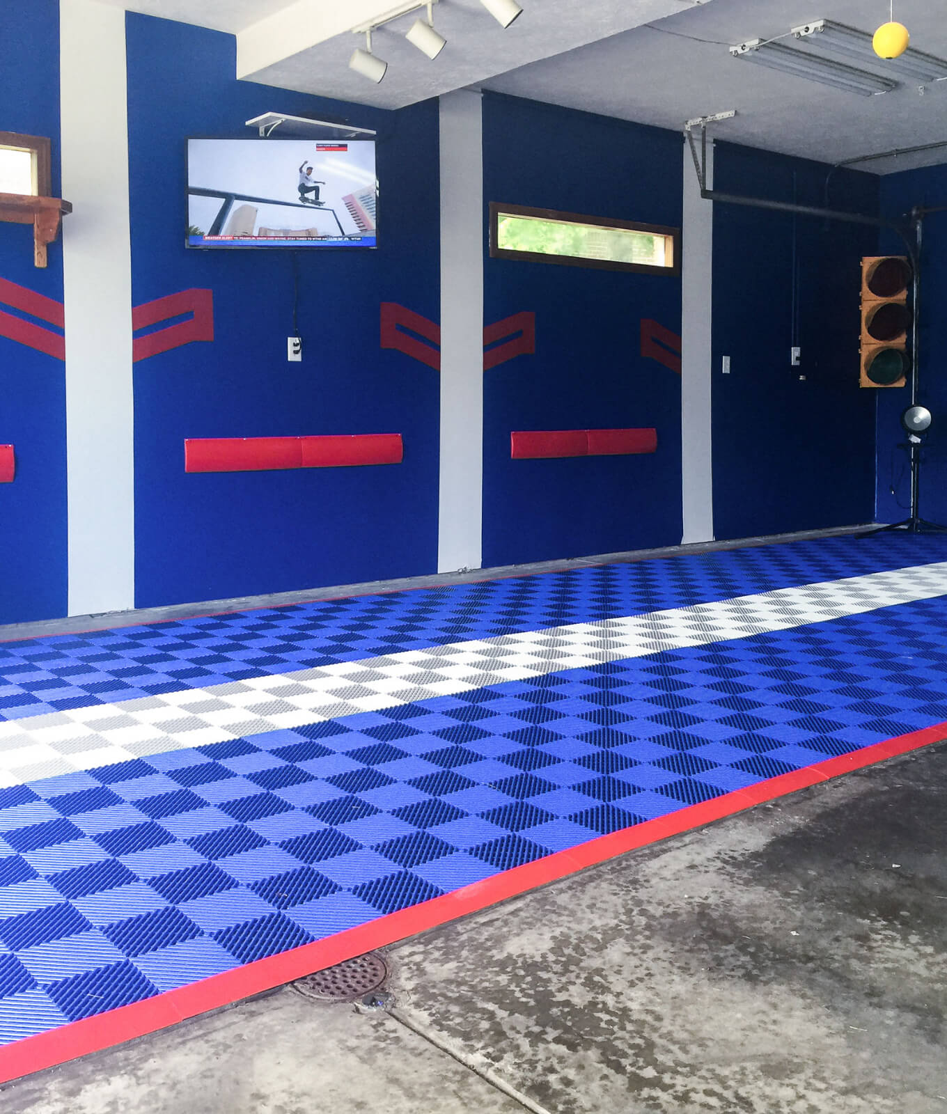 Self-draining Free-Flow royal blue and alloy with red edging being used over a drain.