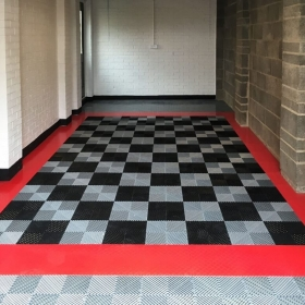 Free-Flow flooring in black and alloy; RaceDeck Diamond red accents.