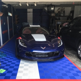Chevy Corvette with royal blue and white Free-Flow garage flooring, with red edging.
