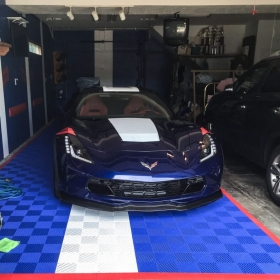Chevy Corvette in a garage with royal blue and white Free-Flow, with red edging.
