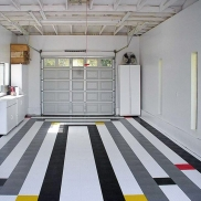Custom garage design with RaceDeck Diamond in black, white, graphite, red and yellow