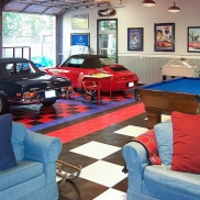 Garage and hangout space with RaceDeck Diamond royal blue, red, black and white flooring.