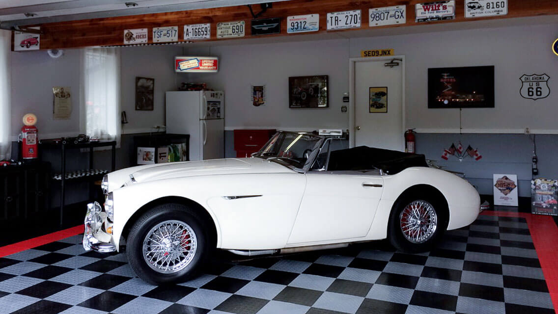 Vintage roadster in a garage with RaceDeck Diamond alloy, black and red.