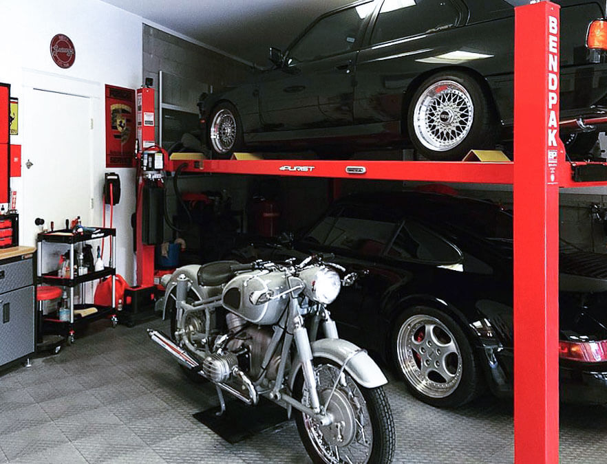 Motorcycle and car lift in garage with RaceDeck Diamond alloy