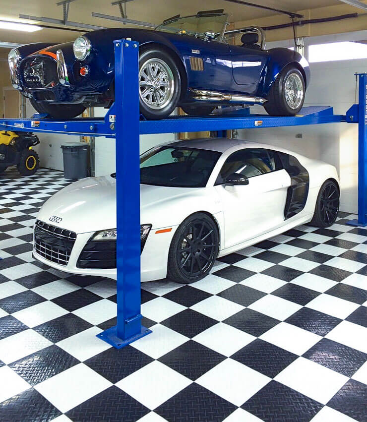 Garage with a two-car lift and checkered black and white RaceDeck Diamond.