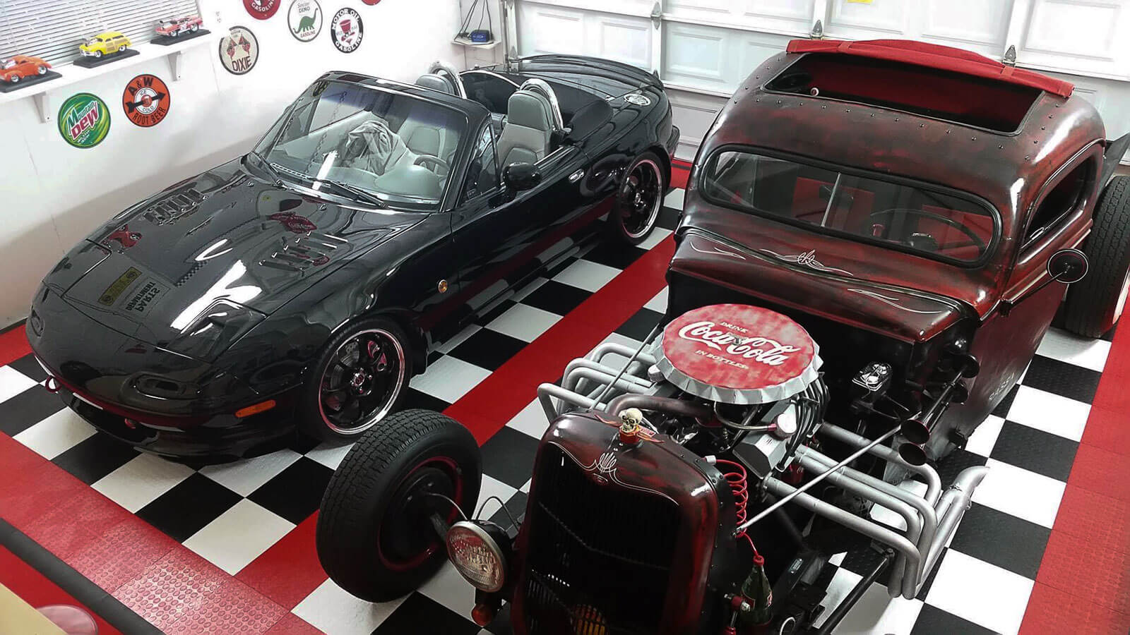 Hot rod garage with checkered black and white RaceDeck Diamond, with red CircleTrac accents.