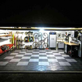 Garage at night with checkered RaceDeck Diamond in alloy and graphite.