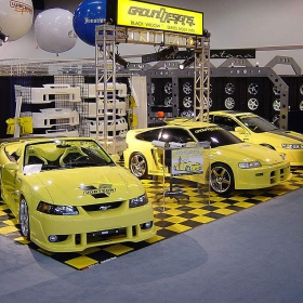 Black and yellow portable display with RaceDeck Diamond flooring and edging