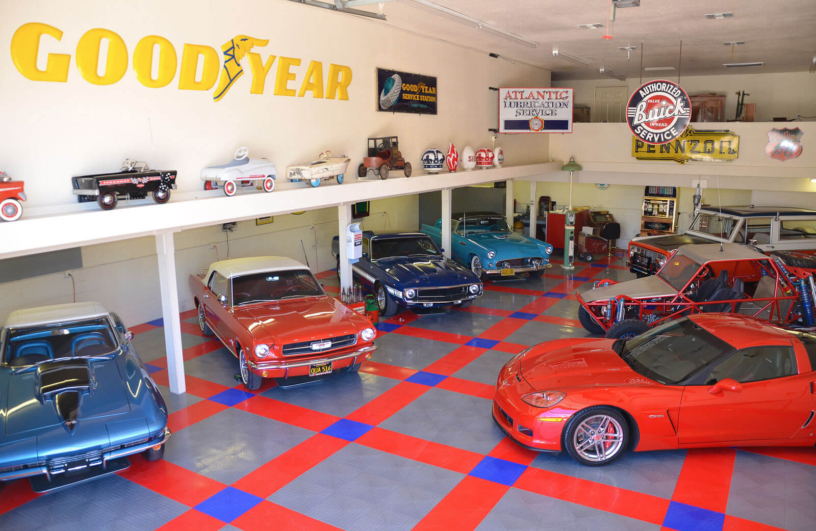 Shop with RaceDeck Diamond red, black and alloy flooring.