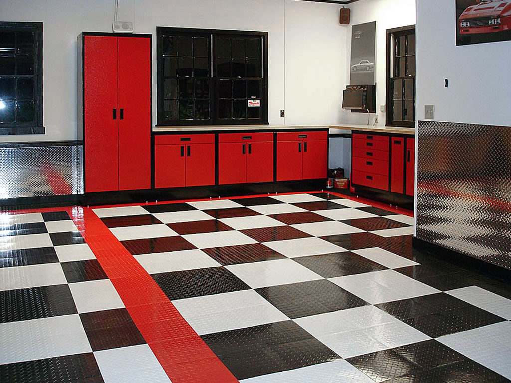 RaceDeck Diamond flooring in black, white and red to match this garage.