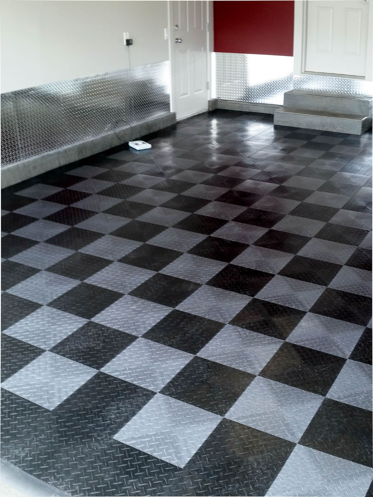 Finished garage with RaceDeck Diamond black and alloy flooring