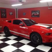 Mustang GT 200 on a checkered black and white RaceDeck XL floor.
