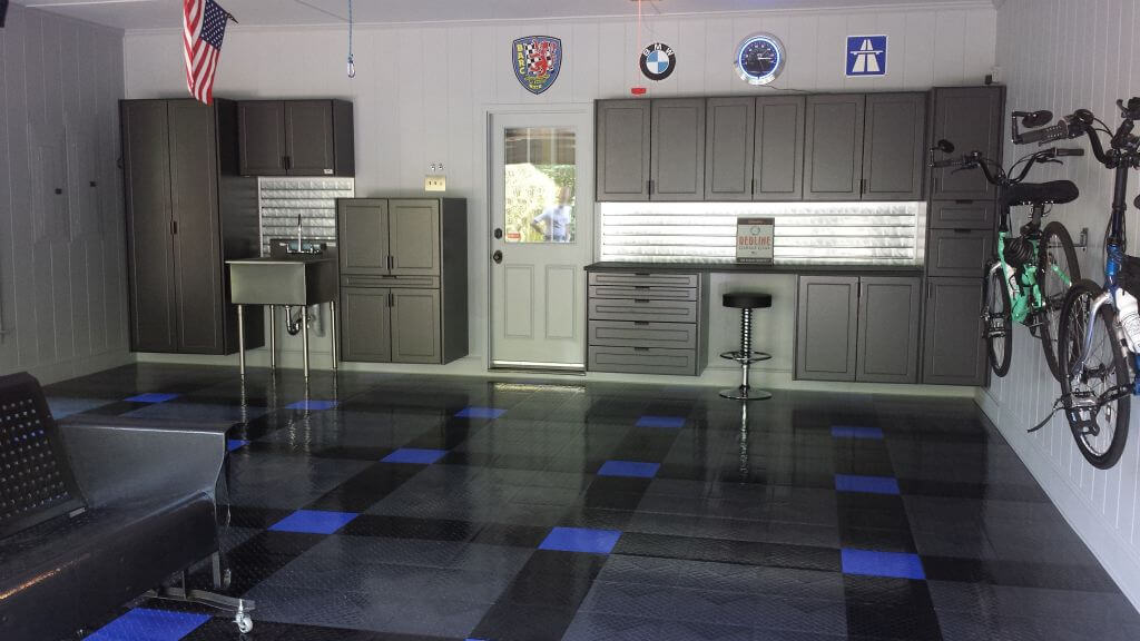 Home garage with RaceDeck Diamond black, graphite, and royal blue flooring.