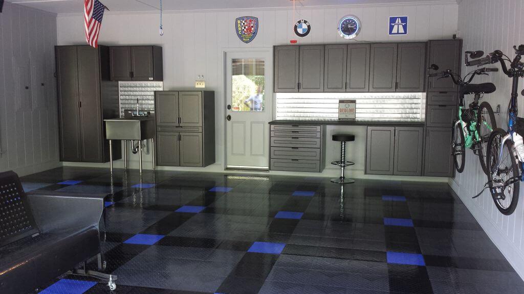 Home garage with RaceDeck Diamond black, graphite, and royal blue flooring.
